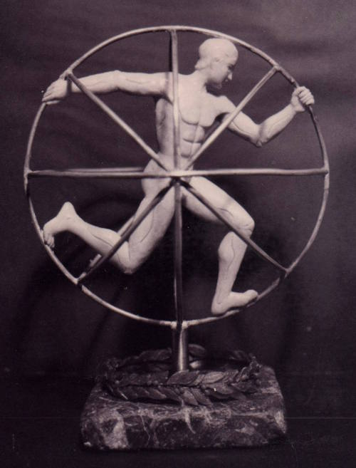 Scultura a tutto tondo in cera metallo e marmo 19 cm x 19 cm. Realizzata in occasione della 1ª mostra d'arte sportiva della Repubblica di S. Marino, 1999